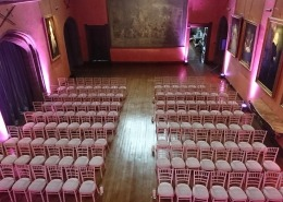 Wedding Ceremony uplighters and chivari chairs at cowdray house bucks hall