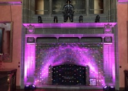 purple uplighters on fireplace at bucks hall