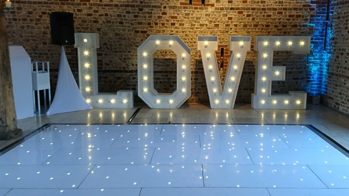 5ft LOVE uplighters and white led dancefloor at upwaltham barns