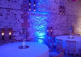 blue uplighters table centerpiece vase and mirror at upwaltham barns chichester