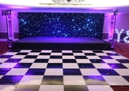 portsmouth marriott hotel individual letters bhlack and white dancefloor stage black starcloth puirple uplighters and stage lighting