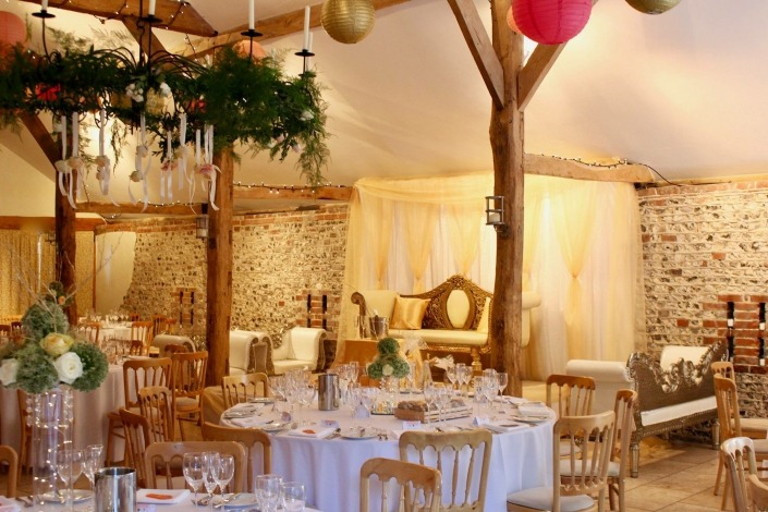 upwaltham barns chichester stage hire backdrop with gold swags