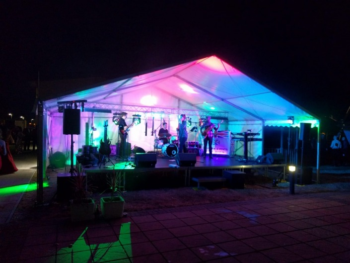 9m marquee end stage deck with sound lighting and band