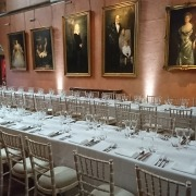 cowdray house white uplighters and chavari chairs trestle tables